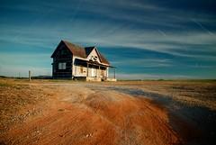 Still Standing (MilkaWay) Tags: winter house abandoned perspective bluesky dirtroad polarizer contrails abandonment gravel madisoncounty desolation georgiaredclay ruralgeorgia ga172 tarpaperhouse explorejanuary42011
