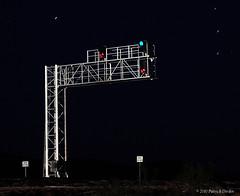 Real or Model (Patrick Dirden) Tags: california nightphotography railroad bridge light night train stars route66 desert illumination rail southerncalifornia bnsf mojavedesert freighttrain sanbernardinocounty us66 burlingtonnorthernsantafe signalbridge historicroute66 bnsfrailroad nationaltrailshighway burlingtonnorthernsantaferailroad ashhill siberiaca