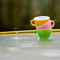 #005708 - tiny cups in the rain, santa cruz, december 2010. (Jeff Merlet Photography) Tags: leica pink santacruz color green film cup water rain yellow 35mm square table published kodak things drop droplet 135 teacup portra m6 08 m6ttl 160 portra160nc c41 summicron35 kidcup scphoto 35c41co jeffmerletphotography jeffmerlet 005708 miscellaneousproject r0057 photojeffmerletcom