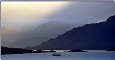 passing showers (Senaid) Tags: blue winter grey boat day showers soundofsleat lochnevis