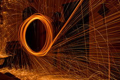 Spinning Steel Wool (Fawzan Hasan) Tags: longexposure light orange house postprocessed home kitchen dark painting table living nikon raw doors nef angle bright room tripod wide overlay burning sofa burn tiles layers dinning lighter sharpen nikkor sparkler sparks bounce levels highpass selectivecolor ruleofthirds spinningsteelwool adobephotoshopcs5 fawzanhasanphotography adobecameraraw6