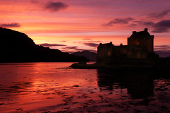 Eilean Donan Castle Sunset, Scotland (flatworldsedge) Tags: sunset red seaweed water composite scotland highlands magenta nostalgia lilac layers ripples loch eileandonan kyleoflochalsh yahoo:yourpictures=lightshade yahoo:yourpictures=waterv2 yahoo:yourpictures=shadows