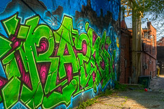 Boldly Stated (Majtek862) Tags: blue light urban color brick green art wall architecture dumpster buildings graffiti alley paint downtown neon perspective magenta sunny kansascity textures glossy fluorescent missouri shade vandalism americana iridescent westport gravel airbrush