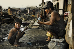Ulingan, Tondo - Bibe, the 12 year old charcoal boy (Mio Cade) Tags: poverty christmas boy party shirt work kid child feeding philippines poor vincent dirty dirt charcoal manila labour feed bibe tondo ulingan