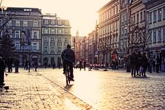 the bicyclist (ewitsoe) Tags: morning light people man cold bicycle 50mm nikon europe dof bokeh poland polska krakow cycle d80 funsittinghereforhoursonend cantwaittoreturnoneday