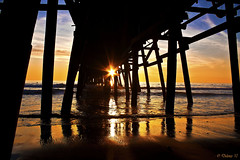 Framed (Didenze) Tags: light sunset reflections golden pier framed explore sunburst sanclemente frontpage underpier parquedelmar canon450d didenze