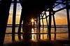 Framed (Didenze) Tags: light sunset reflections golden pier framed explore sunburst sanclemente frontpage underpier parquedelmar canon450d didenze