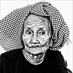 Portrait of time (-clicking-) Tags: old portrait blackandwhite bw woman monochrome sepia asia faces time character country mother vietnam elderly oldlady visage oldtime eld vietnamesewomen blackwhitephotos vietnamesemother chndung nhchndung nhentrng oladwoman countrymother flickrtravelaward mvitnam olamother bmqu