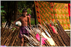 Football is life [..Chuadanga, Bangladesh..] (Catch the dream) Tags: boy smile children football colorful child expression shy clothes passion saree bangladesh fuel drying footballer sharee shychild cowdung chuadanga footballislife ghutey passionatefootballer gettyimagesbangladeshq2