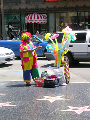 Hollywood Clown (See El Photo) Tags: ca street city people urban 15fav favorite man color guy cars make stars fun outside outdoors star funny colorful vibrant clown makeup vivid tie convertible stranger rednose dude pump wig hollywood 100views greatshot streetperformer fav autos performer ballons wacky colorz vender 1f faved automoblie coloredhair 111v1f cityofangeles ballonanimals aveofstars intenselyhued