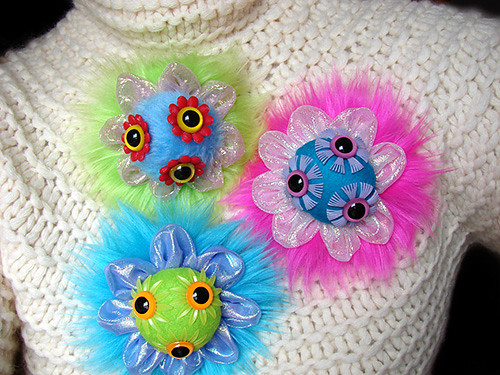 Tri-eye Brooches