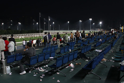 Home time, abandoned betting slips cover the ground