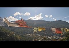 Bhutan- Countryside (jonathan whelan) Tags: sky forest asia bhutan prayer sunny flags hills whelan