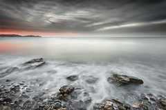 Like a Dream (Landscape Version) (DavidFrutos) Tags: longexposure seascape beach water stone clouds sunrise interestingness agua rocks stones playa paisaje