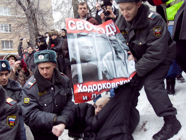 Russia -- Police detain a participant of a rally to demand freedom for Khodorkovsky and Lebedev near the building of Khamovnichesky court in Moscow, 27Dec2010
