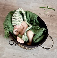 Elf in a Basket (Kidzmom2009) Tags: sleeping baby green basket innocent knithat woodfloor handonface wovenbasket elfhat babyinabasket kidzmom2009 familygetty2010 kfsphotography