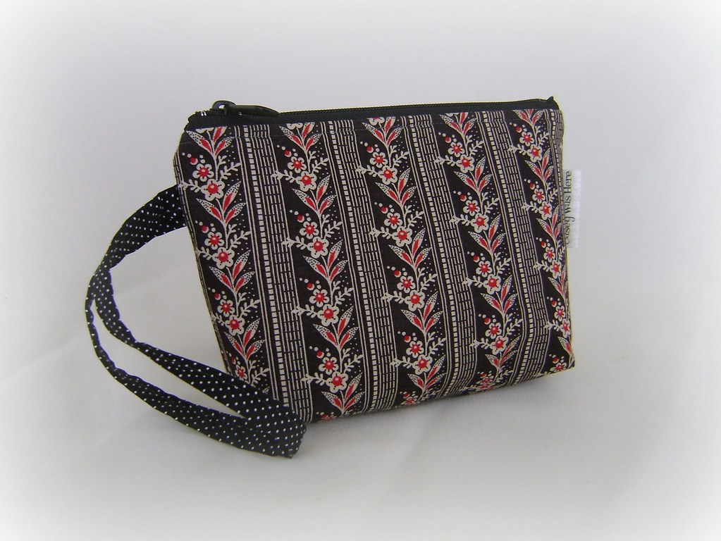Black and White with a touch of red flowers wristlet