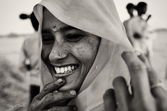 Blushing (Sayid Budhi) Tags: portrait people bw india girl smile field lady happy village veil happiness fatehpursikri human bwblackandwhite rurallife northindia uttarpradesh incredibleindia ladyinveil photographictour humaninterestphotography villagerlife travelasiaphotographycom