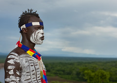 Karo warrior in Omo valley - Ethiopia (Eric Lafforgue) Tags: africa travel people horizontal kara collier necklace exterior artistic outdoor couleurs african seat profile helmet decoration tribal bijou adventure ornament blackpeople omovalley bodypainting ethiopia tribe ethnic rite karo bun tabouret jewel ethnicity adornment afrique pigments tribu ethiopian omo eastafrica abyssinia headrest tribesman ethiopie blackskin exterieur 5335 tribalportrait colorpicture ethnique abyssinie ethnie omoriver photocouleur kolcho afriquedelest nomadicpeople colourpicture korcho cluleur valleedelomo clayhelmet peoplesoftheomovalley appuitete appuinuque
