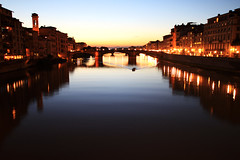 Arno reflections in Florence (` Toshio ') Tags: city longexposure bridge sunset italy reflection building history water architecture river evening boat florence ancient europe wake italia european cityscape dusk historical firenze arno europeanunion arnoriver toshio