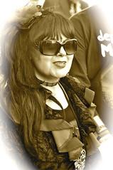 _DSC1603 (petelovespurple) Tags: whitbygothweekend whitby women girls goths gothic goth gothicweekendcostumesdressupvictorianedwardianfashionmakeupmakeupelizabethanvampirevampiresjetwhitbyjetdraculasteampunkalternativeretrofetishperiodvelvetblacksilkleatherbowlerhatsfangsbootswaistcoa sepia boots pantyhose