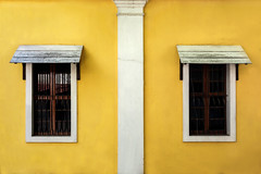 """A Tale of Two Windows (""""The Wanderer's Eye Photography"""") Tags: 2016 bangalore canoneos450d canoneosdslr canoneosrebelxsi digitalphotography india photography pondicherry puduchery rubenalexander susanalexander thewandererseyephotography architecture background building color colorful design exterior facade grunge home house line lines obsolete old outside retro side simple simplicity street style summerhouse sunlight texture timber vintage wall window windows wood wooden yellow symmetry"""