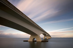 To the other side II (Kees Smans) Tags: longexposure bridge sky water netherlands clouds landscape nederland zeeland brug dutchlandscape zeelandbrug colijnsplaat daytimelongexposure zeelandbridge bwnd110 keessmans 2010keessmans