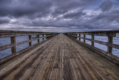 The Pier (HDR) (Brandon Godfrey) Tags: wood sea canada texture water clouds photoshop point grey pier boards dock day bc cloudy britishcolumbia sony details overcast victoria symmetry pacificnorthwest boardwalk straight alpha dslr vanishing westcoast knots sidney hdr highdynamicrange haro