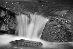 The Smallest Waterfall (Paul_Sch) Tags: california park camera longexposure autumn motion fall wet water rock digital creek river flow waterfall nikon rocks smooth rocky fresno flowing dslr silky 2010 woodwardpark smoothness d90 fresnoca