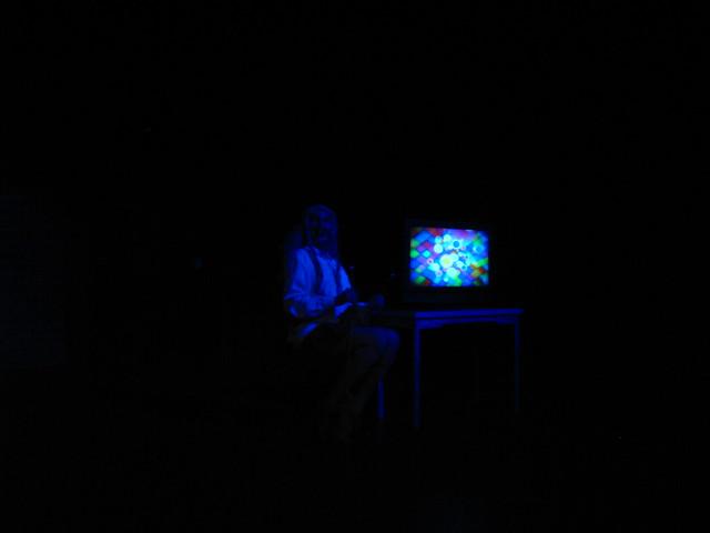The aged Scheissefrau (Jaime Robledo) tells her story.