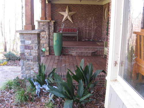 brick porch flanked with stone columns viewed from the side on a home in southwest Raleigh, North Carolina