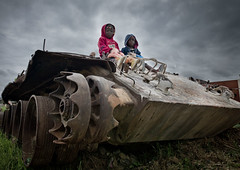 Kids Playing on a Tank - Huambo Angola (Eric Lafforgue) Tags: tourism kids children army kid war doll tank military civilwar weapon char guerre angola tourismo 02201 instantfave guerrecivile bfv1   angolagate