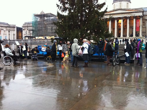 Long shot of protesters lined up under the Xmas tree