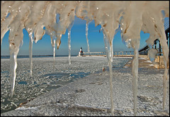Icing Up (Tom Gill.) Tags: winter lighthouse lake ice pier indiana lakemichigan michigancity pancakeice laportecounty flowice
