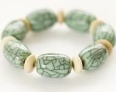 Stretch bracelet: Nepalese aqua copal, bone