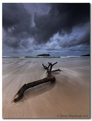 Breaking the rules. (danishpm) Tags: ocean sea seascape sunrise canon sand surf cloudy australia wideangle stormy driftwood rainy nsw aussie aus 1020mm manfrotto fingal sigmalens northernrivers eos450d fingalheads 450d tweedshire dragondaggerphoto dragondaggeraward dragondaggerawardshalloffame sorenmartensen hitechgradfilters 09ndsoftgrad