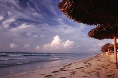 Golden sand of Varadero (Anton Novoselov) Tags: ocean trip autumn vacation sky white film beach umbrella island freedom evening sand paradise fuji minolta projector scanner 5 cuba slide atlantic iso velvia chrome fidel che 100 28 mm dynax af 35 guevara noritsu