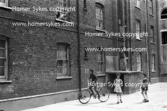 TENEMENT BUILDING TOWER HAMLETS EAST LONDON 1970S BRITAIN (Homer Sykes) Tags: poverty uk england people london tower english home person estate flat britain poor shoreditch housing british 1970 1970s deprived whitechapel peabody spitalfields slum eastlondon workingclass housingestate hamlets gbr towerhamlets londonlondon archivestock