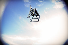 the flying blue chair! (Valerio Loi) Tags: wood blue light sky cloud contrast freedom fly jump chair paint blind spin sit swirl vignette throw