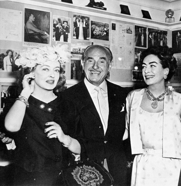 Bette Davis, Jack Warner and Joan Crawford