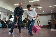 USS Stockdale chaplain plays a game with Korean child. (Official U.S. Navy Imagery) Tags: ship navy armada destroyer sailor usnavy carrier unitedstatesnavy chinhae republicofkorea marineros stockdale handicappedchildren navychaplain