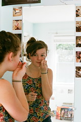 This Is How I Paint (emibell) Tags: selfportrait color kodak polaroids nikonf2 2009 mirrorshot cfp colorfilm colorfilmphotography eyelinerheart emibell
