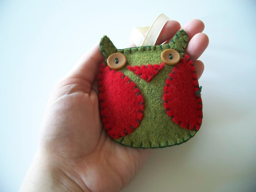 green owl ornament in hand