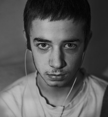 To hear you is to confuse me, Leave me in my world, not yours (Andreas-photography) Tags: boy lost 50mm nikon andrea essex autism d700