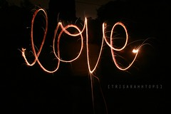 Love (Sarah Ching) Tags: light red summer orange black hot love sarah night speed dark fire slow bright july fast sparklers shutter fourth spark cursive slowshutterspeed trisarahhtops