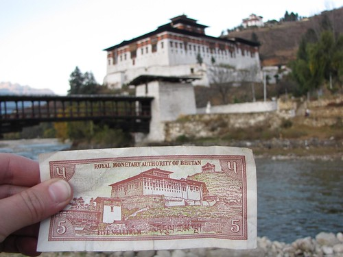 old 5 Ngultrum note and Paro Dzong