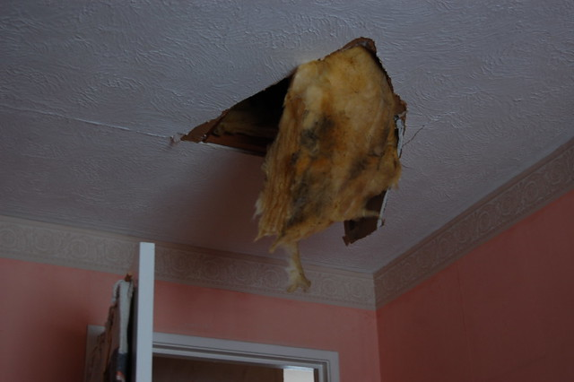 A hole from the loft into one of the rooms, where it was stood on by accident