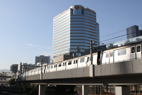 Train passing the MTR headquarters at Kowloon Bay