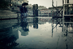 On Alaskan (sparth) Tags: seattle leica blue reflection umbrella grey washington couple downtown december x1 2010 parapluie alaskanway seattledowntown leicax1