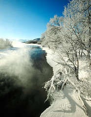 Cold Water Fog (www.toddklassy.com) Tags: travel blue trees winter sky sunlight mist snow cold west color ice water weather vertical fog rural creek river season landscape outdoors countryside frozen woods montana colorful stream frost crystals day mt bright snowy hoarfrost empty branches horizon vivid atmosphere bank sunny bluesky nobody visit steam clear shore covered fallen edge recreation copyspace glaciernationalpark lookingdown icy frigid desolate stmary scenics belowzero stockphoto verycold wooded stockphotography babb colorimage tributary ruralscene beautyinnature blackfeetindianreservation glaciercounty stmaryriver toddklassy montanatravelphotographer